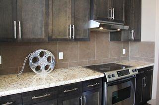 Photo 9: 47 ASPEN STONE Manor SW in Calgary: Aspen Woods Detached for sale : MLS®# A1028178