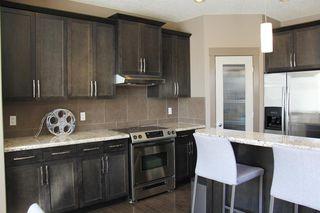 Photo 6: 47 ASPEN STONE Manor SW in Calgary: Aspen Woods Detached for sale : MLS®# A1028178