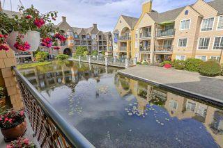 "Photo 1: 201 5555 13A Avenue in Delta: Cliff Drive Condo for sale in ""WINDSOR WOODS"" (Tsawwassen)  : MLS®# R2465619"
