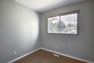 Photo 18: 125 MIDBEND Place SE in Calgary: Midnapore Row/Townhouse for sale : MLS®# A1018473