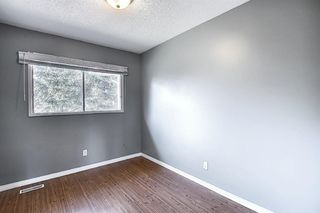Photo 16: 125 MIDBEND Place SE in Calgary: Midnapore Row/Townhouse for sale : MLS®# A1018473