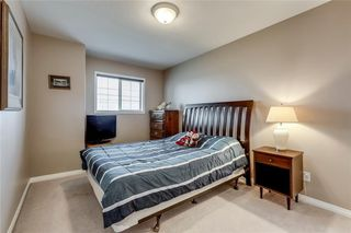 Photo 30: 4 12 SILVER CREEK Boulevard NW: Airdrie Row/Townhouse for sale : MLS®# A1029688