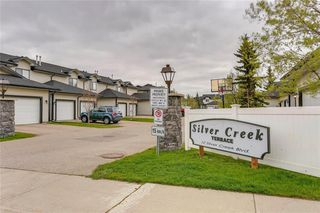 Photo 42: 4 12 SILVER CREEK Boulevard NW: Airdrie Row/Townhouse for sale : MLS®# A1029688