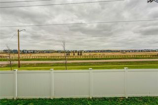 Photo 41: 4 12 SILVER CREEK Boulevard NW: Airdrie Row/Townhouse for sale : MLS®# A1029688