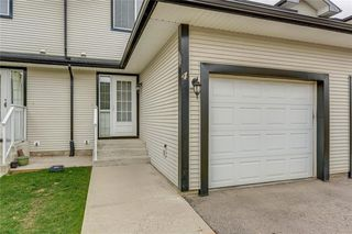 Photo 9: 4 12 SILVER CREEK Boulevard NW: Airdrie Row/Townhouse for sale : MLS®# A1029688
