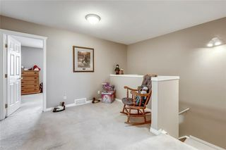 Photo 25: 4 12 SILVER CREEK Boulevard NW: Airdrie Row/Townhouse for sale : MLS®# A1029688