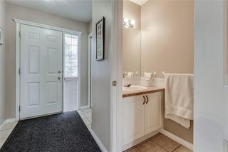 Photo 12: 4 12 SILVER CREEK Boulevard NW: Airdrie Row/Townhouse for sale : MLS®# A1029688