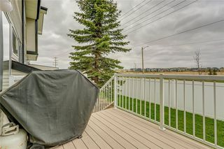 Photo 40: 4 12 SILVER CREEK Boulevard NW: Airdrie Row/Townhouse for sale : MLS®# A1029688