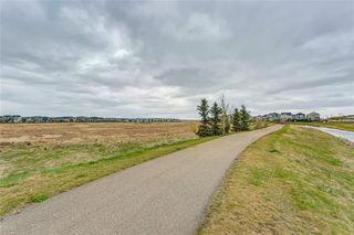 Photo 7: 4 12 SILVER CREEK Boulevard NW: Airdrie Row/Townhouse for sale : MLS®# A1029688