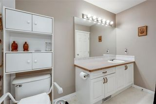 Photo 28: 4 12 SILVER CREEK Boulevard NW: Airdrie Row/Townhouse for sale : MLS®# A1029688