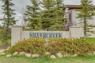 Photo 2: 4 12 SILVER CREEK Boulevard NW: Airdrie Row/Townhouse for sale : MLS®# A1029688