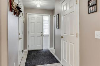 Photo 10: 4 12 SILVER CREEK Boulevard NW: Airdrie Row/Townhouse for sale : MLS®# A1029688