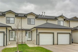 Photo 3: 4 12 SILVER CREEK Boulevard NW: Airdrie Row/Townhouse for sale : MLS®# A1029688