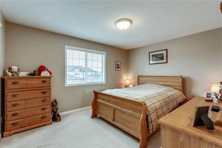 Photo 26: 4 12 SILVER CREEK Boulevard NW: Airdrie Row/Townhouse for sale : MLS®# A1029688