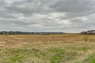 Photo 6: 4 12 SILVER CREEK Boulevard NW: Airdrie Row/Townhouse for sale : MLS®# A1029688