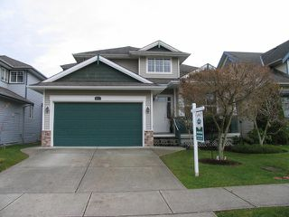 "Photo 1: 6238 167A ST in Surrey: Cloverdale BC House for sale in ""CLOVER RIDGE"" (Cloverdale)  : MLS®# F1300016"