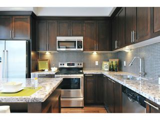 "Photo 12: 108 1480 SOUTHVIEW Street in Coquitlam: Burke Mountain Townhouse for sale in ""CEDAR CREEK"" : MLS®# V1021704"