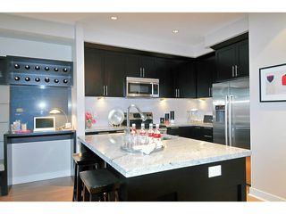 "Photo 3: 108 1480 SOUTHVIEW Street in Coquitlam: Burke Mountain Townhouse for sale in ""CEDAR CREEK"" : MLS®# V1021704"