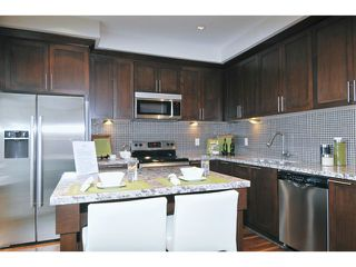 "Photo 11: 108 1480 SOUTHVIEW Street in Coquitlam: Burke Mountain Townhouse for sale in ""CEDAR CREEK"" : MLS®# V1021704"