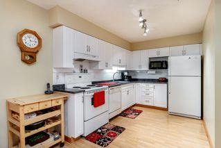 "Photo 3: 108 9688 148 Street in Surrey: Guildford Condo for sale in ""Hartford Woods"" (North Surrey)  : MLS®# R2413566"