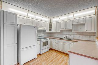 Photo 3: 325 8535 BONAVENTURE Drive SE in Calgary: Acadia Apartment for sale : MLS®# A1011393