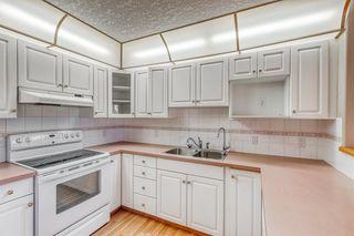 Photo 4: 325 8535 BONAVENTURE Drive SE in Calgary: Acadia Apartment for sale : MLS®# A1011393