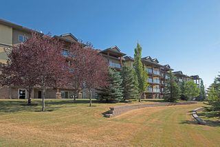 Photo 4: 1202 92 Crystal Shores Road: Okotoks Apartment for sale : MLS®# A1027921