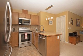 Photo 19: 1202 92 Crystal Shores Road: Okotoks Apartment for sale : MLS®# A1027921