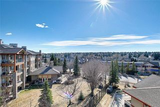 Photo 1: 1410 LAKE FRASER Green SE in Calgary: Lake Bonavista Apartment for sale : MLS®# C4294063