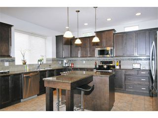 "Photo 4: 24760 KIMOLA Drive in Maple Ridge: Albion House for sale in ""MAPLE CREST"" : MLS®# V966255"