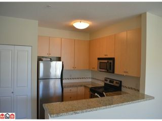 "Photo 3: 308 15299 17A Avenue in Surrey: King George Corridor Condo for sale in ""FLAGSTONE WALK"" (South Surrey White Rock)  : MLS®# F1227568"