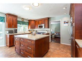 """Photo 12: 8168 154 Street in Surrey: Fleetwood Tynehead House for sale in """"FAIRWAY PARK"""" : MLS®# R2497613"""