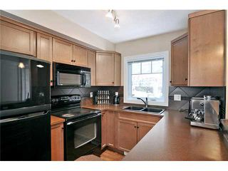 Photo 3: 3 ROYAL OAK Plaza NW in CALGARY: Royal Oak Townhouse for sale (Calgary)  : MLS®# C3530912