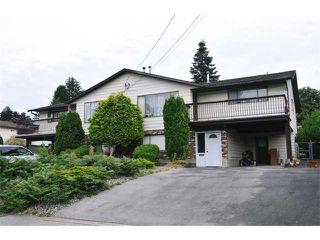 Photo 1: 617 LEA Avenue in Coquitlam: Coquitlam West House Duplex for sale : MLS®# V968344