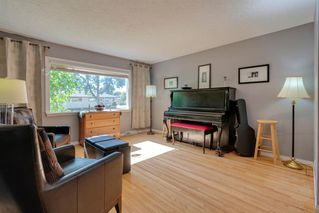 Photo 6: 136 41 Avenue NW in Calgary: Highland Park Semi Detached for sale : MLS®# A1027994