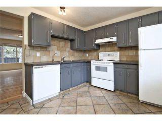 Photo 2: 62 2815 PALLISER Drive SW in CALGARY: Oakridge Townhouse for sale (Calgary)  : MLS®# C3535290