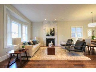 Photo 2: 928 E 20TH AV in Vancouver: Fraser VE House for sale (Vancouver East)  : MLS®# V1032676
