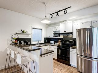 Photo 11: 1 3718 16 Street SW in Calgary: Altadore Row/Townhouse for sale : MLS®# A1029418