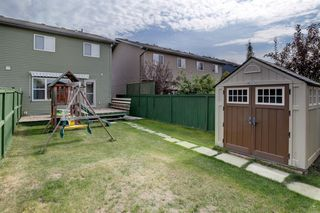 Photo 31: 205 EVERSYDE Boulevard SW in Calgary: Evergreen Semi Detached for sale : MLS®# A1034000