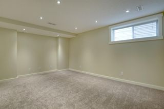 Photo 26: 205 EVERSYDE Boulevard SW in Calgary: Evergreen Semi Detached for sale : MLS®# A1034000