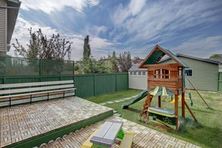 Photo 29: 205 EVERSYDE Boulevard SW in Calgary: Evergreen Semi Detached for sale : MLS®# A1034000