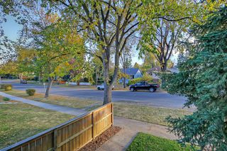 Photo 2: 228 27 Avenue NW in Calgary: Tuxedo Park Semi Detached for sale : MLS®# A1043141