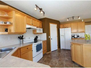 Photo 5: 401 STONEGATE Road NW: Airdrie Residential Detached Single Family for sale : MLS®# C3577038