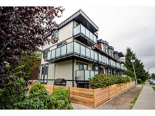 "Photo 1: 202 1205 W 14TH Avenue in Vancouver: Fairview VW Townhouse for sale in ""SIGNATURE PLACE"" (Vancouver West)  : MLS®# V1083796"