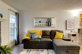 Photo 4: 161 76 Glamis Green SW in Calgary: Glamorgan Row/Townhouse for sale : MLS®# A1053014