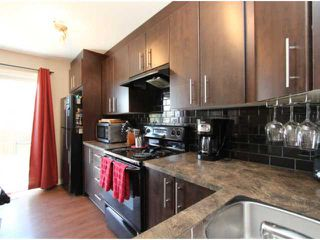 Photo 5: 602 2445 KINGSLAND Road SE: Airdrie Townhouse for sale : MLS®# C3624049