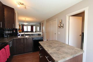 Photo 6: 602 2445 KINGSLAND Road SE: Airdrie Townhouse for sale : MLS®# C3624049