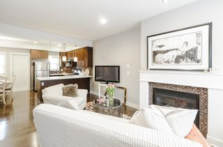 Photo 1: 4176 WELWYN STREET in Vancouver: Victoria VE Townhouse for sale (Vancouver East)  : MLS®# R2041102