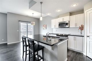 Photo 4: 1301 881 SAGE VALLEY Boulevard NW in Calgary: Sage Hill Row/Townhouse for sale : MLS®# C4305688