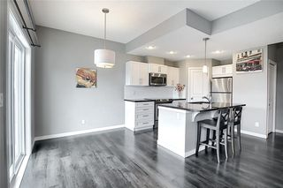 Photo 10: 1301 881 SAGE VALLEY Boulevard NW in Calgary: Sage Hill Row/Townhouse for sale : MLS®# C4305688